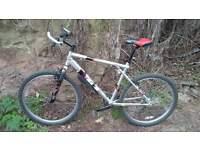 His 'n Hers matching pair GT Aggressor Three Mountain Bikes
