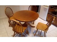 Circular dining table with 4 chairs