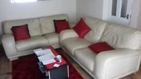 Cream leather settees 2 & three setters very good condition can deliver in local area