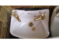 I have a second hand small basin, taps and plug included and toilet for sale