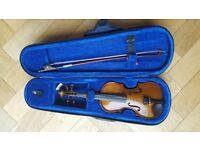 A Stentor 1/10 violin and case
