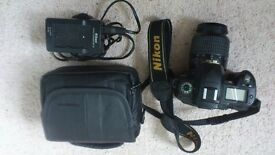Nikon DSLR D70 with accessories and bag.