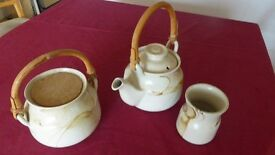 Barbara Dickson Scottish Pottery Teapot, Biscuit Barrel and Posy vase in wicker basket.