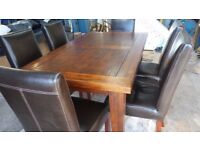 Large solid wood dining table and chairs