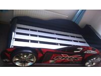 *BETTER THAN HALF PRICE* Red Car Single Bed (practically new) *Mattress included*