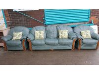 Large green leather three piece living room suite