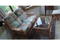 Two seater Conservatory Sofa and matching glass topped table, in excellent condition.