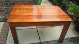 Solid dark wood table with 4 high back chairs.
