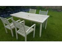 Large wooden garden table and 4 chairs.