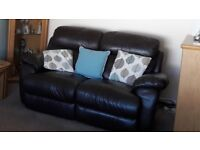 2 brown leather sofas one electric recliner one fixed sofa