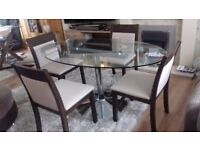 Oval Glass Table on a Chrome Circular Base with 4 Solid Wood and fabric Chairs