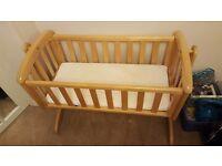 Swinging crib including mattress