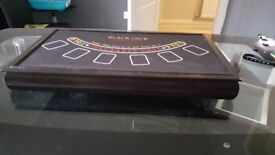 Mini casino with roulette wheel, black jack, craps table cars and chips