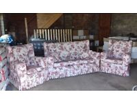 Quaint reupholstered 3 seater sofa with 2 chairs, a foot stool and 2 matching throw pillows.