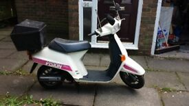HONDA VISION 50 motorbike in good condition as left in garage