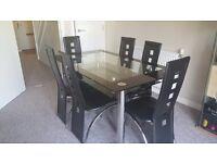 Szklany stół +6 krzeseł oraz narożnik z funkcją spania