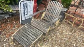 Old cast iron chairs with foot stools and table frame