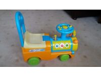 TOYS U RUS SIT AND RIDE OR PULL ALONG TRAIN .