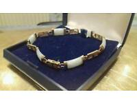 9ct gold jade bracelet.