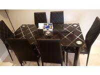 Stunning Black Glass Dining Table with Six Faux Leather Patterned Chairs