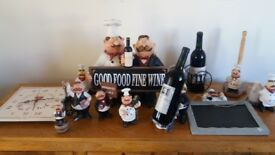 Mr giles kitchen ornaments.clock,wine holders,corkscrews,salt and peppers etc