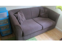 Dark brown, fabric sofa bed with matching cushions