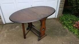 Fold out drop leaf dining table