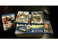 Playstation Vita boxed with 5 games and extras