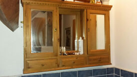 Wooden cabinet with mirrors