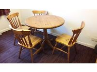 Circular solid Pine Table and 4 matching Chairs
