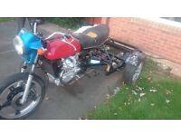 2 honda motorbikes (1 is honda cx500, the other 125cc honda)