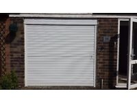 Automatic rolling garage shutter with remote control