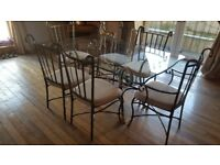 Glass table with 6 chairs in vg condition