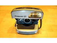 Polaroid Instant Camera. 3 Pictures Left.