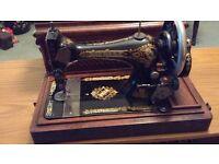 Vintage Style Hand Crank Singer Sewing Machine.