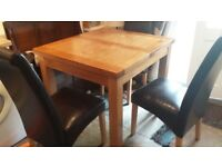 Excellent condition. Solid Oak Extendable Dining Table