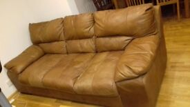 Two three seater brown leather sofas sold together or separately .