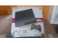 PLAY STATION 3 CONSOLE WITH TWO CONTROLLER AND 11 GAMES IN GOOD CONDITION