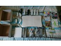 NINTENDO wii console 5 controllers and games