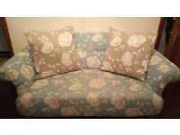 DFS Teal two Seater sofa with white flowers its like new hardly been sat on!
