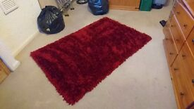 Lovely quality thick red shaggy rug
