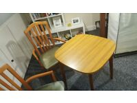 A small table and 2 chairs