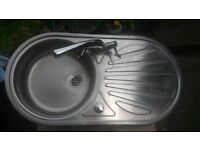 Round sink with drainer and mixer tap