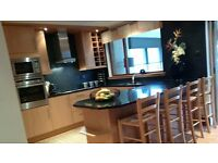 Fully fitted kitchen complete with granite worktops