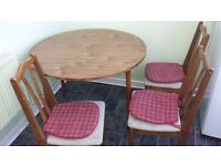Round drop leaf dining table + 3 chairs