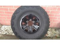 A 4 set of black Mitsubishi alloys, size front 31 X 10.50 R15 and back 31 X 10.50 R15