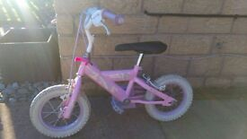 SMALL GIRLS BIKE WITH 12.5 INCH WHEELS IN GOOD CONDITION