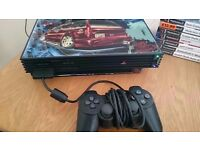 Playstation 2 with games and 2 controllers