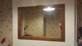 Very large wooden frame mirror