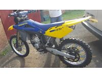 Yellow & Blue Husqvarna Motorbike for sale.
